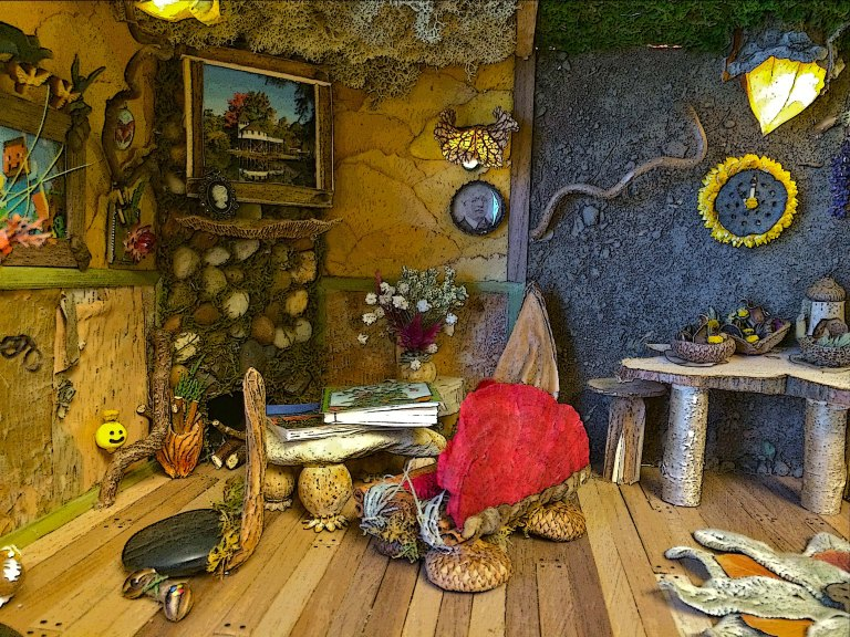 "A ""Mouse House"", design & construction by Laurel Matthew. Note the poppy seed heads as table legs, and the acorn caps as feet on the sofa legs."